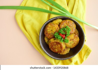 Perkedel, Indonesian fried ground potato minced beef patties garnish with parsley and red chili