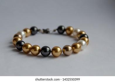 A perl bracelet on a light background