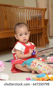 Perlis, Malaysia - Jan,2017: Cute 1 year old baby playing indoors. family gathering event at parent house on weekend