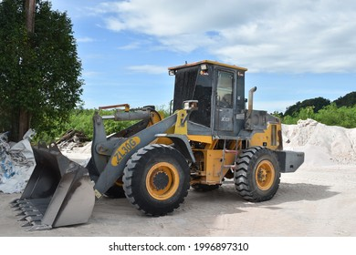 Perlis, Malaysia - June 25 2021: Heavy wheel loader excavator are commonly used for the mining industry