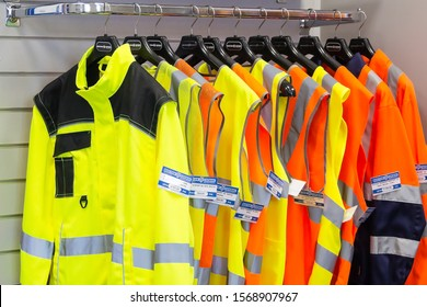 Perm city, Russia - March 18, 2019. Shop of special clothes. Car driver and road workers special clothing - new bright jackets with reflective stripes in showroom