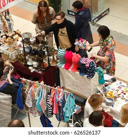 "PERM, RUSSIA - APRIL 15, 2017: A big sale, a fair of handmade things in the mall, hypermarket ""Stolitsa"". Goods, masters, buyers. Top view flea market, garage sale. Hand made souvenirs at the market"