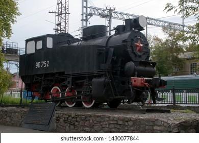 Perm Russia Aug 29 2012, vintage locomotive on display at  Railway station Perm No 1
