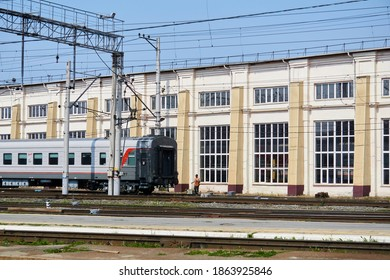 Perm, Russia - August 07, 2020: shunting work with passenger cars against the background of the depot building