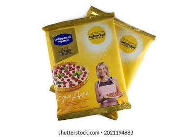 """Perm, Russia - August, 07, 2021: two packages of frozen puff pastry of the brand """"Edim Doma"""" on a white background."""