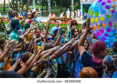 Perm, Russia, August 19th-2016, park Gorkogo. Close up of hands raised up  in the Colour holi festival.
