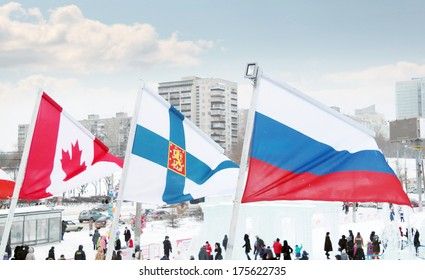 PERM, RUSSIA - JAN 6, 2014: Flags of participating countries (Canada, Finland, Russia) of Winter Olympic Games in Ice town, created in honor of Winter Olympic Games 2014 will be in Sochi, Russia.