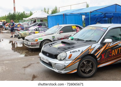 PERM, RUSSIA - JUL 22, 2017: Sport cars with advertising at Open Ural Championship Drift 2017