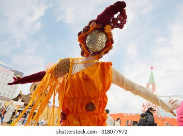 PERM, RUSSIA - JUN 15, 2014: Woman in costume dances on street theaters show at open air White Nights