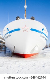 Perm, Russia - March 11.2017: Fragment of a three-deck motor ship in winter parking in the backwaters of the Kama River