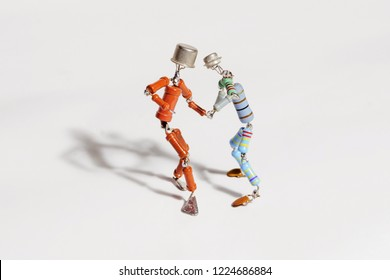 Perm, Russia - November 4, 2018: two funny small human figures, roughly welded  from resistors and transistors, dance together on a light background