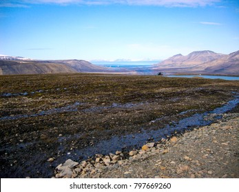 Permafrost melting in summer sun on the slopes of Spitzbergen (Svalbard) near Longyearbyen.