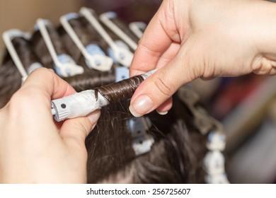 Permanent hair in a beauty salon