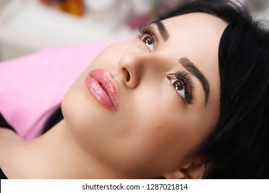Permanent Make-up on her Lips.