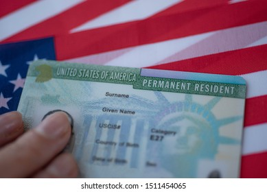 Permanent Resident Green card  of United states of America on flag of USA. Above close up view.  - Shutterstock ID 1511454065
