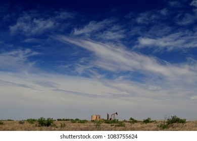 Permian Basin oil production, Texas Sky and pump jack in color