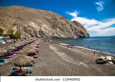 Permissa black sand beach in Santorini. Greece.