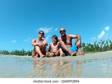 Pernambuco, Brazil, September 22, 2012.Family enjoying the beach of Carneiros, in the state of Pernambuco, in the Northeast region of Brazil.