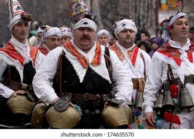 PERNIK, BULGARIA - JAN 25, 2014: Traditional Kukeri costume are seen at the the International Festival of the Masquerade Games Surva in Pernik, Bulgaria. Photo taken on: January 25th, 2014