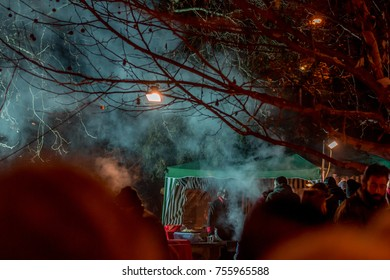 PERNIK, BULGARIA - JANUARY 27, 2017: Part of the crowd is waiting in line to buy freshly prepared food outdoors at Surva, the International Festival of the Masquerade Games