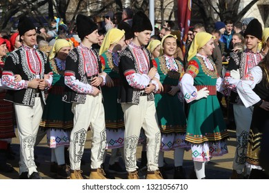 Pernik, Bulgaria - January 27, 2019: People dressed with traditional Bulgarian authentic folklore clothes dance bulgarian horo in Pernik, Bulgaria