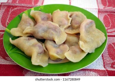 perogies with cherries on a plate. homemade food, dumplings