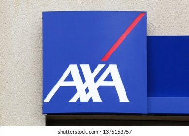 Peronnas, France - April 7, 2019: AXA insurance logo on a wall. AXA is a French multinational insurance firm that engages in global insurance, investment management and financial services