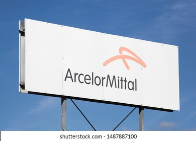 Peronnas, France - August 10, 2019: ArcelorMittal logo on a panel. ArcelorMittal is a multinational steel manufacturing corporation and it is the world's largest steel producer