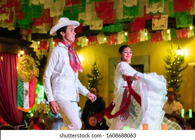 PEROTE, VERACRUZ- SEPTEMBER 15, 2019: Portrait of a young couple dressed with traditional clothes from Veracruz, dancing at Mexican Independence Day party at Perote, Veracruz, Mexico