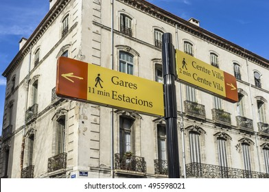 PERPIGNAN,FRANCE-FEBRUARY 3,2014: City signs distance center and station, and building in center city of Perpignan,Languedoc-Roussillon,France.