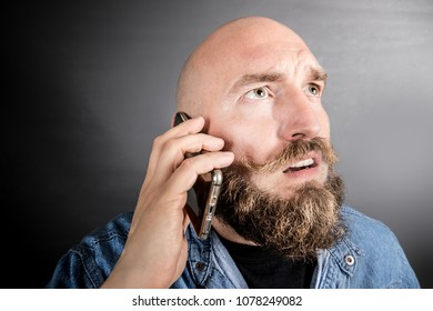 perplexed man talking on the phone