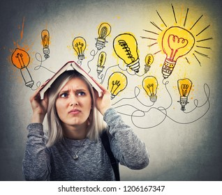 Perplexed young woman holding a opened book over head having many ideas, has to choose the best. Stressed emotion, hard thinking looking at shining light bulbs over head.