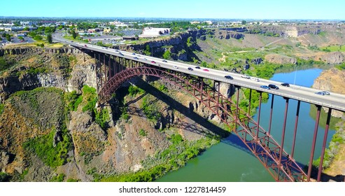 Perrine Bridge, Twin Falls, Idaho, USA - Distant Aerial View Over River Canyon With Cars Driving On Road