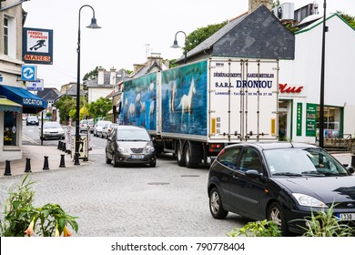 PERROS-GUIREC, FRANCE - JULY 2, 2010: car traffic on street Boulevard Aristide Briand in Perros-Guirec town in summer evening. Perros-Guirec is commune in the Cotes-d'Armor department in Brittany