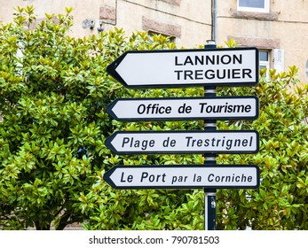 PERROS-GUIREC, FRANCE - JULY 2, 2010: road signs on Place de l'Hotel de Ville in Perros-Guirec town in summer evening. Perros-Guirec is commune in the Cotes-d'Armor department in Brittany