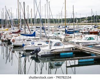 PERROS-GUIREC, FRANCE - JULY 2, 2010: yachts in pontoon port Marie Augustine of Perros-Guirec town. Perros-Guirec is commune in the Cotes-d'Armor department in Brittany in northwestern France