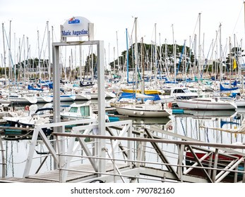 PERROS-GUIREC, FRANCE - JULY 2, 2010: entrance to pontoon port Marie Augustine of Perros-Guirec town. Perros-Guirec is commune in the Cotes-d'Armor department in Brittany in northwestern France