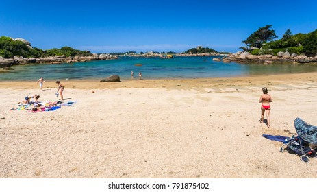 PERROS-GUIREC, FRANCE - JULY 3, 2010: people on beach Saint-Guirec near Ploumanac'h site of Perros-Guirec commune on Pink Granite Coast of Cotes-d'Armor department of Brittany in sunny summer day