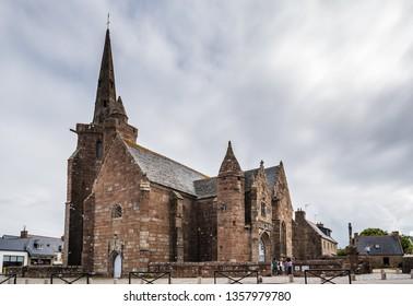 Perros-Guirec, France - July 30, 2018: Chapel of Notre Dame de la Clarte at Perros-Guirec against cloudy sky