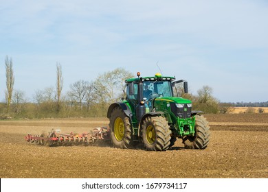Perry Green, Much Hadham, Hertfordshire. UK. March 22nd 2020 . Tractor preparing a field for a spring crop