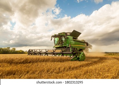 Perry Green, Much Hadham, Hertfordshire. UK. August 24th 2020. Combine harvester harvesting Barley in a field.
