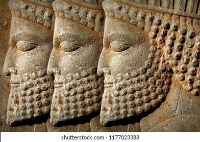 Persepolis is the capital of the ancient Achaemenid kingdom. Iran. Ancient Persia. Bas-relief carved on the walls of old buildings. Ancient background.