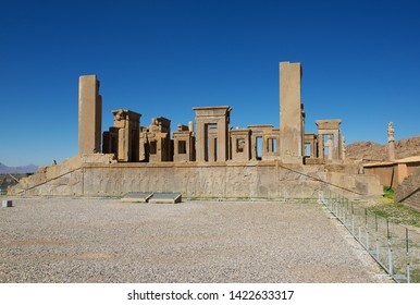 Persepolis is the capital of the ancient Achaemenid kingdom. Sight of Iran. Ancient Persia. Blue sky and clouds background.No people