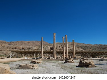 Persepolis is the capital of the ancient Achaemenid kingdom. Sight of Iran. Ancient Persia. Blue sky and clouds background