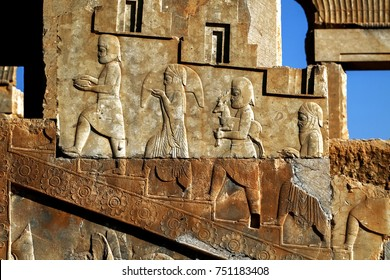 Persepolis is the capital of the ancient Achaemenid kingdom. Sight of Iran. Ancient Persia. Bas-relief carved on the walls of old buildings. Subjects donate.