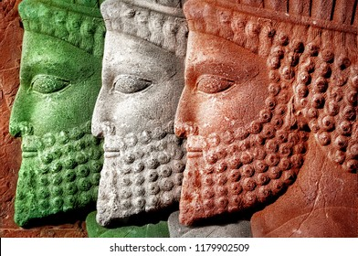 Persepolis. Iran. Ancient Persia. Bas-relief carved on the walls of old buildings. Colors of national flag of Iran.