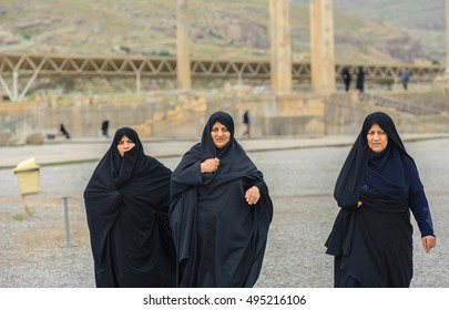 Persepolis, Iran, April 16, 2016 - three women in hijabs walk according to the Persepolis