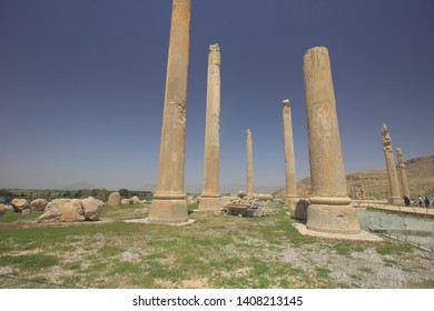 Persepolis, Iran - April 18 2019. The  stone columns remains of Apadana Palace which is part of the ruins of Persepolis, the ancient capital of old Persian Achaemenid Empire in Iran.