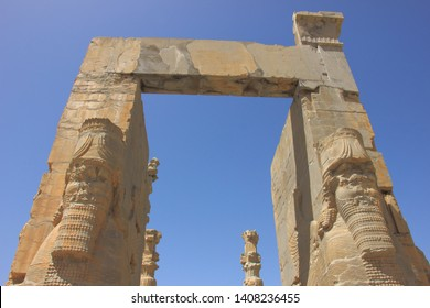 Persepolis, Iran - April 18 2019. The front view of the remaining ruins of Gate of All Nations in Persepolis, the ancient capital of old Persian Achaemenid Empire in Iran..