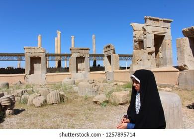 Persepolis, Iran - April 2016.  An Iranian girl in front of the ruins of Persepolis